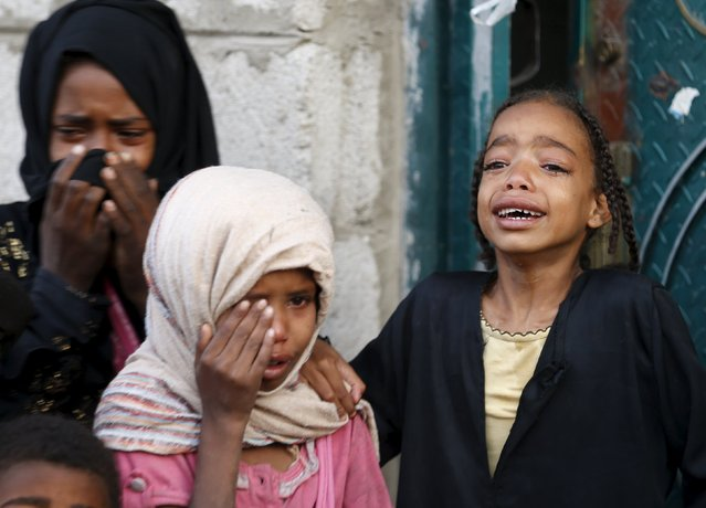 Girls cry after some of their relatives were killed by a Saudi-led air strike in Yemen's capital Sanaa July 13, 2015. (Photo by Khaled Abdullah/Reuters)