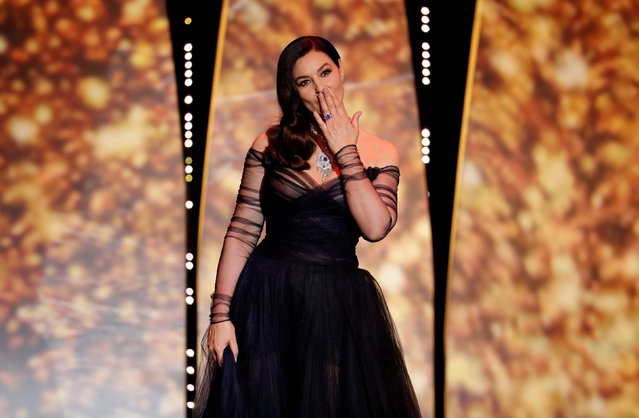 Italian actress and master of ceremonies Monica Bellucci blows kisses as she arrives on stage on May 17, 2017 during of the opening ceremony of the 70 th edition of the Cannes Film Festival in Cannes, southern France. (Photo by Eric Gaillard/Reuters)