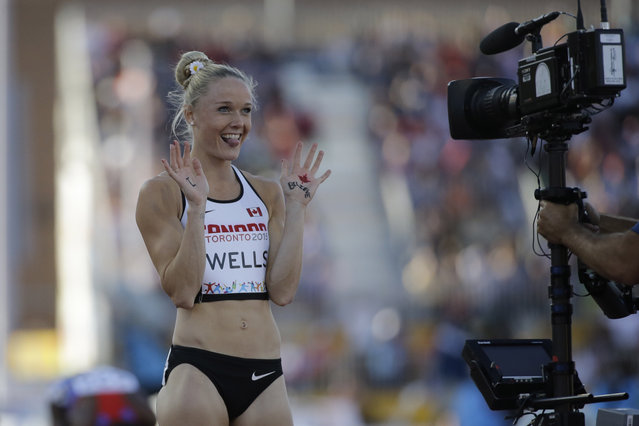 Canada's Sarah Wells gestures to a camera after the final of the women's 400 meter hurdles at the Pan Am Games Wednesday, July 22, 2015, in Toronto. Wells won the silver medal in the event. (Photo by Mark Humphrey/AP Photo)