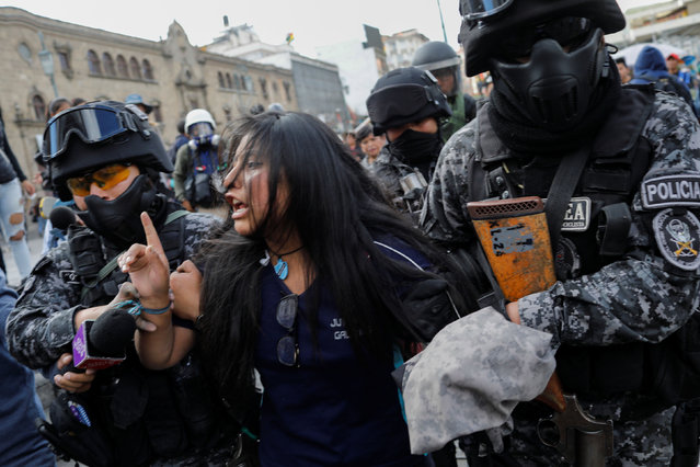 A demonstrator is detained by riot police during a protest, in La Paz, Bolivia on November 21, 2019. Bolivia's interim President Jeanine Anez asked Congress Wednesday to approve a law that would allow for new elections, after deadly unrest following the resignation of Evo Morales and the disputed October 20 ballot. (Photo by Marco Bello/Reuters)