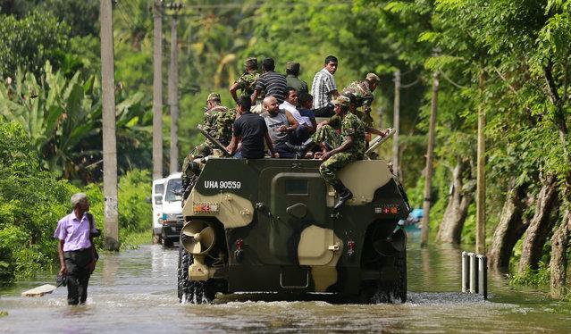 Sri Lankan army soldiers evacuate flood victims stranded at Agalawatte in Kalutara district, Sri Lanka, Saturday, May 27, 2017. (Photo by Eranga Jayawardena/AP Photo)