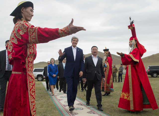 U.S. Secretary of State John Kerry (center L) and Mongolian Foreign Minister Lundeg Purevsuren arrive to attend a Naadam ceremony, a competition which traditionally includes horse racing, Mongolian wrestling and archery, in Ulan Bator, Mongolia, June 5, 2016. (Photo by Saul Loeb/Reuters)