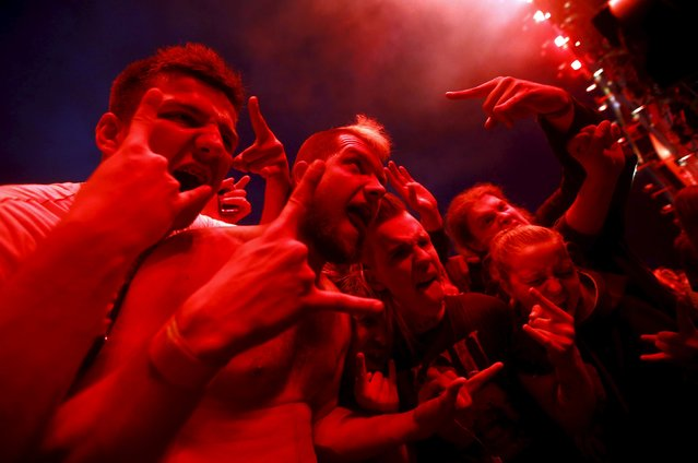 Revelers react as they listen to the music in front of the main stage during the 21st Woodstock Festival in Kostrzyn-upon-Odra, Poland July 30, 2015. (Photo by Kacper Pempel/Reuters)