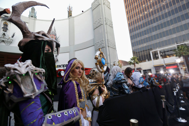 """Cosplay enthusiasts wait at the premiere of the movie """"Warcraft"""" in Hollywood, California U.S., June 6, 2016. (Photo by Mario Anzuoni/Reuters)"""