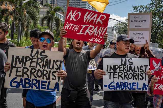 Filipinos take part in a protest versus US aggression against Iran, at the US embassy on January 6, 2020 in Manila, Philippines. The protest was held in response to increased tensions in the Middle East as a result of a U.S. airstrike that killed Iranian Military Commander Qasem Soleimani last week. (Photo by Ezra Acayan/Getty Images)