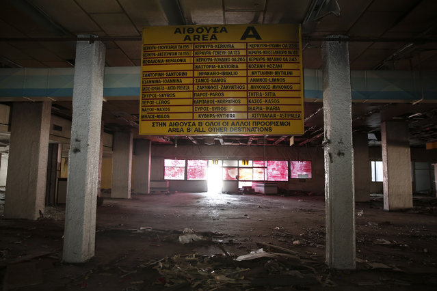 A board is seen inside a deserted hall at the west terminal of the former Athens International airport, Hellenikon June 16, 2014. (Photo by Yorgos Karahalis/Reuters)