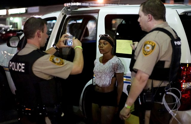 Police take a mug shot of a protester who was detained in Ferguson, Missouri, August 10, 2015. (Photo by Rick Wilking/Reuters)