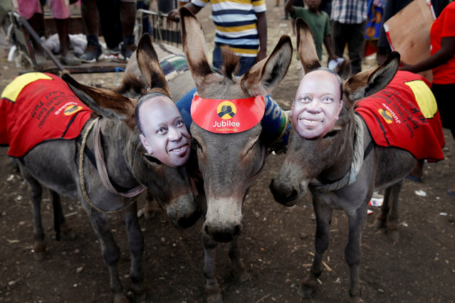 Donkeys wearing masks depicting Kenya's President Uhuru Kenyatta stand during a Jubilee Party election rally in Nairobi, Kenya. July 21, 2017. (Photo by Baz Ratner/Reuters)
