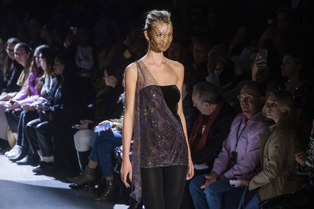 The Christian Cowan collection is modeled at Spring Studios during NYFW Fall/Winter 2020 on Tuesday, February 11, 2020, in New York. (Photo by Charles Sykes/Invision/AP Photo)