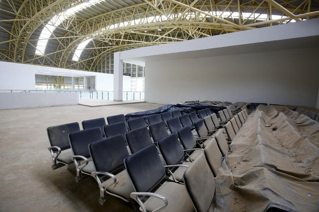 Dust covered seats are pictured inside the lounge of the Jaisalmer Airport in desert state of Rajasthan, India, August 13, 2015. (Photo by Anindito Mukherjee/Reuters)