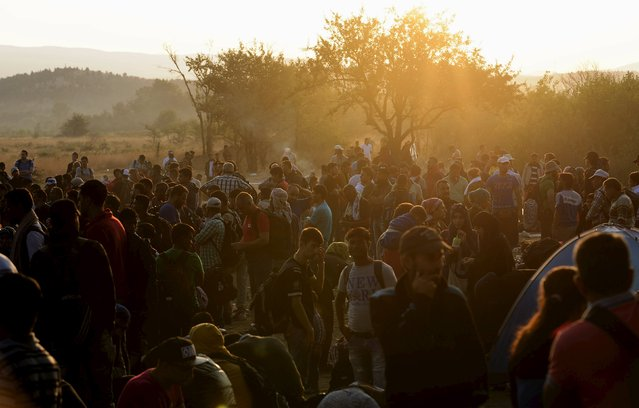 A new group of more than a thousand immigrants wait at the border line of Macedonia and Greece to enter into Macedonia near Gevgelija railway station August 20, 2015. (Photo by Ognen Teofilovski/Reuters)
