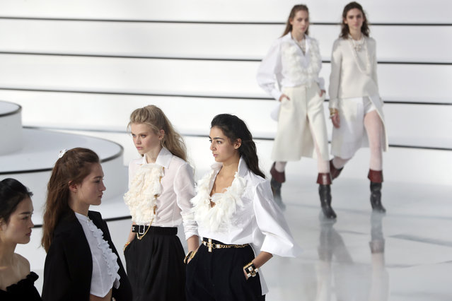 Models wear creations for the Chanel fashion collection during Women's fashion week Fall/Winter 2020/21 presented in Paris, Tuesday, March 3, 2020. (Photo by Thibault Camus/AP Photo)