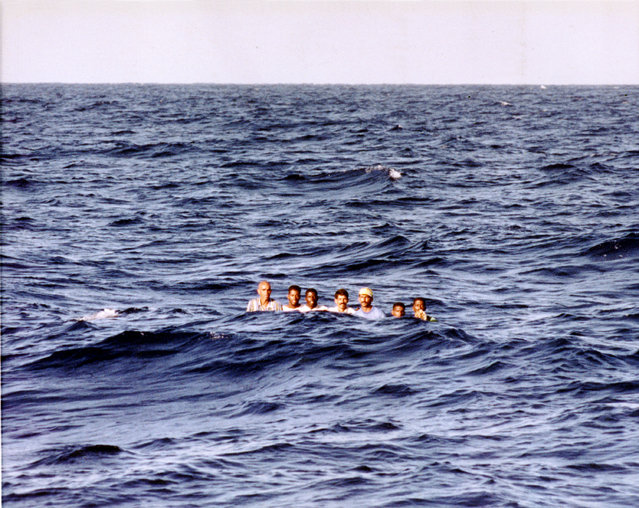 Cuban Rafters battle high seas before being picked up by the U.S. Coast Guard cutter Gallatin on August 26, 1994. The Cubans will later be transferred to a Navy ship bound to Guantanamo Bay, Cuba. (Photo by Steve Helber/AP Photo)