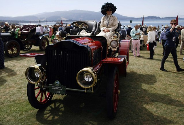 An entrant sits on a 1907 White Model G Runabout Prototype during the Concours d'Elegance at the Pebble Beach Golf Links in Pebble Beach, California, August 17, 2014. (Photo by Michael Fiala/Reuters)