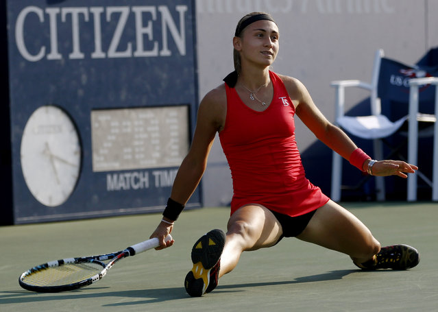 Aleksandra Krunic, of Serbia, slides on the court as she watches her shot fall against Madison Keys, of the United States, during the second round of the 2014 U.S. Open tennis tournament, Thursday, August 28, 2014, in New York. (Photo by Frank Franklin/AP Photo)