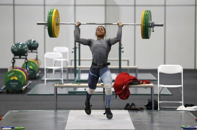 2016 Rio Olympics, Copacabana on July 29, 2016. Weightlifter Roilya Ranaivosoa from Mauritius practices. (Photo by Athit Perawongmetha/Reuters)