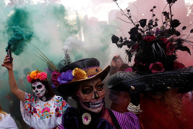 """Women dressed up as """"Catrina"""", a Mexican character also known as """"The Elegant Death"""", take part in a Catrinas parade in Mexico City, Mexico on October 22, 2017. (Photo by Carlos Jasso/Reuters)"""