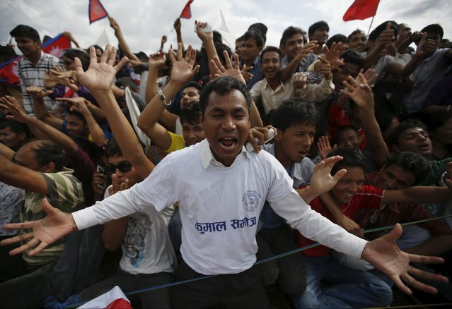 People cheer as they gather during a celebration a day after the first democratic constitution was announced in Kathmandu, Nepal September 21, 2015. (Photo by Navesh Chitrakar/Reuters)