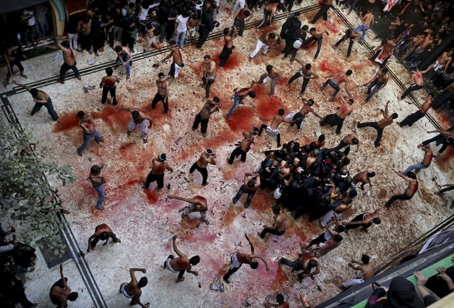 Blood is splatered on the floor of a mosque as Shiite Muslims flagellate themselves during a Muharram procession in New Delhi, November 25, 2012. (Photo by Kevin Frayer/Associated Press)