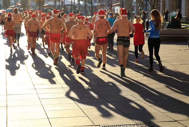 People take part in a half naked Santa run in downtown Budapest, Hungary, December 10, 2017. (Photo by Bernadett Szabo/Reuters)