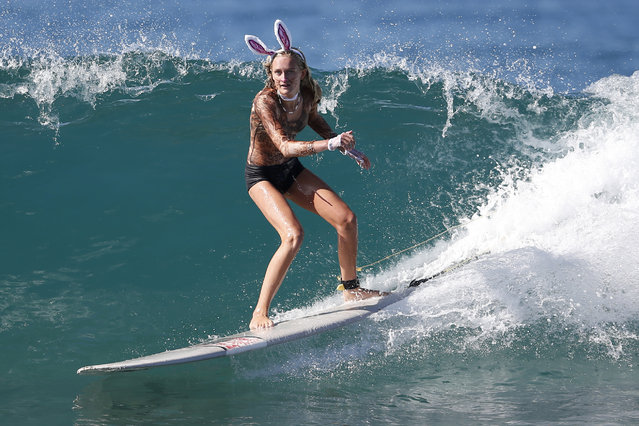 Vienna Werner, 16, rides a wave dressed as a rabbit during the 7th annual ZJ Boarding House Haunted Heats Halloween surf contest. (Photo by Lucy Nicholson/Reuters)