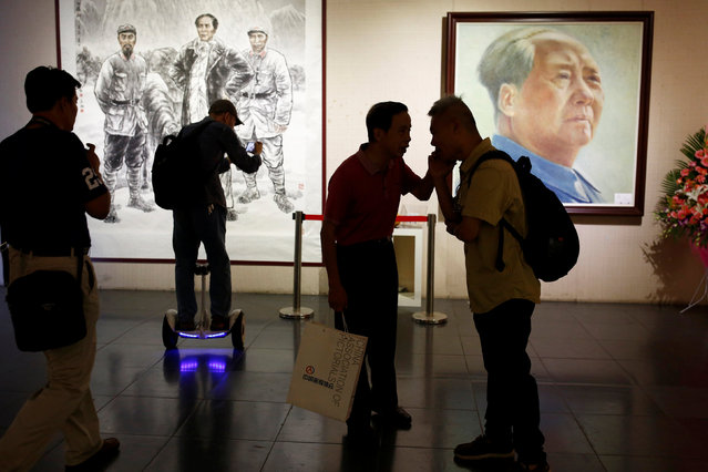 People attend the opening of an exhibition of images related to late Chinese Chairman Mao Zedong in Beijing, China, September 8, 2016. (Photo by Thomas Peter/Reuters)