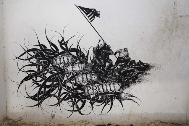 "Graffiti reading ""The Few, The Proud"", made by a previous deployment of the U.S Marine Corps, adorns the walls at Musa Qala in Helmand province, Afghanistan November 10, 2010. (Photo by Finbarr O'Reilly/Reuters)"