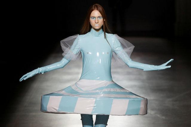 A model presents a creation by graduates of the Open Fashion Studio clothing design school during Ukrainian Fashion Week in Kyiv, Ukraine on September 3, 2020. (Photo by Valentyn Ogirenko/Reuters)
