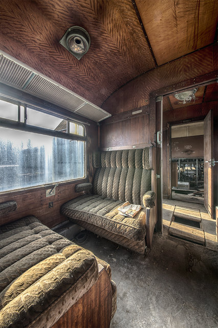 These pictures reveal the crumbling ruins of the famed Grand Orient Express, now hollowed-out and almost reduced to rubble. There are only a couple of the trains, launched in 1883, left in the world. This example stands dormant in Belgium, untouched from its last voyage in the winter of 2009. Rusty ceilings, moth-eaten seats and tattered floors capture its level of decay. A Rotterdam-based urban photographer Brian Romeijn managed to snap these pictures while exploring the area. (Photo by Brian Romeijn/IMP Features)