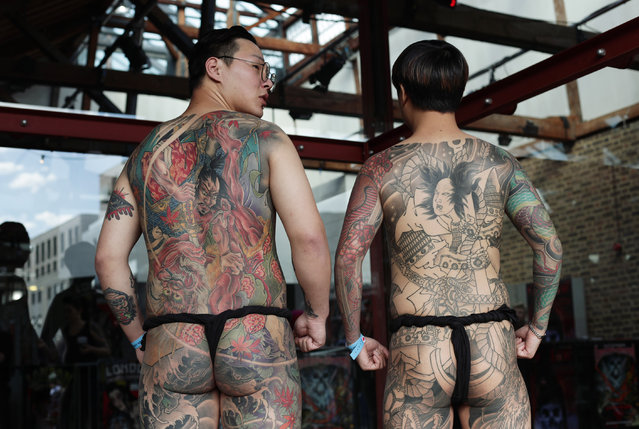 Meagan (left) and Seoyul, both from South Korea, attending the London International Tattoo Convention at Tobacco Dock in London on September 23, 2016. (Photo by Yui Mok/PA Wire)