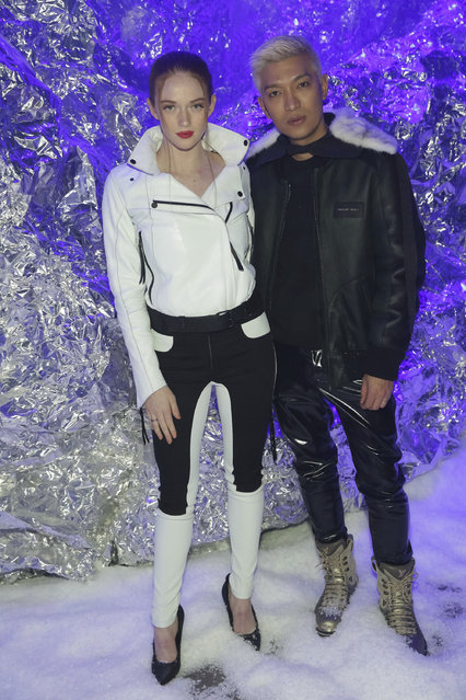 Larsen Thompson, left, and Bryanboy attend the Philipp Plein 2018 Fall/Winter Runway Show during New York Fashion Week at The Brooklyn Navy Yard on Saturday, February 10, 2018, in New York. (Photo by Brent N. Clarke/Invision/AP Photo)