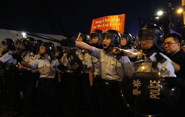 Police shout at pro-democracy protesters during a rally close to the chief executive office in Hong Kong, November 30, 2014. (Photo by Tyrone Siu/Reuters)