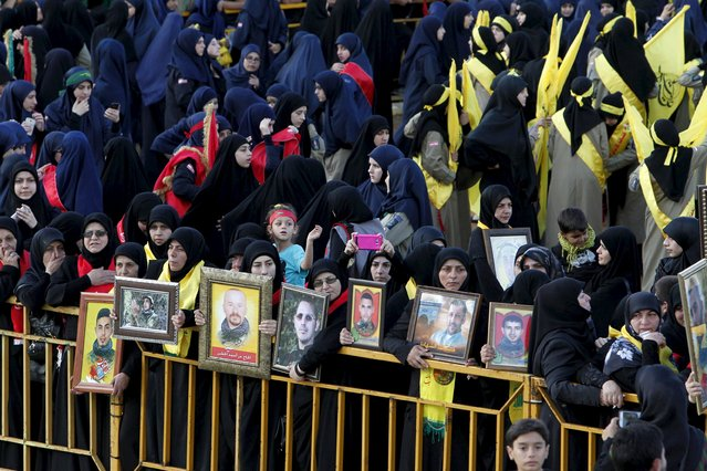 Women carry pictures of dead fighters as Lebanon's Hezbollah members, supporters and relatives attend the funeral of three Hezbollah fighters who were killed while fighting alongside Syrian army forces in Syria in Nabatieh town, southern Lebanon, October 27, 2015. (Photo by Ali Hashisho/Reuters)