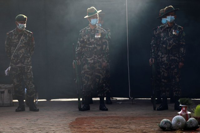 """Nepalese army personnel wearing protective face masks take part in Nawami, a sacrificial ceremony during """"Dashain"""", the biggest religious festival for Hindus, amid the outbreak of the coronavirus disease (COVID-19) in Kathmandu, Nepal on October 25, 2020. (Photo by Navesh Chitrakar/Reuters)"""