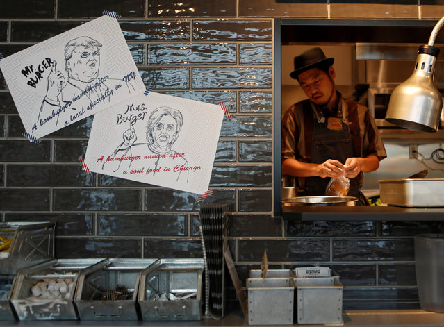 J.S. Burgers Cafe chef Yasuhito Fukui prepares Mr. and Mrs. Burger featuring the U.S. presidential candidates Hillary Clinton and Donald Trump at the hamburger joint in Tokyo, Japan October 7, 2016. (Photo by Megumi Lim/Reuters)