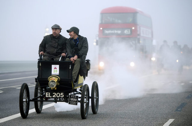 An 1899 Locomobile (steam) car drives over Westminster Bridge during the Royal Automobile Club's annual London to Brighton veteran car run, London, Britain, 01 November 2015. Around 500 vehicles participate in the 60 mile event that begins in Hyde Park, central London and finishes in Brighton, Sussex. (Photo by Hannah Mckay/EPA)