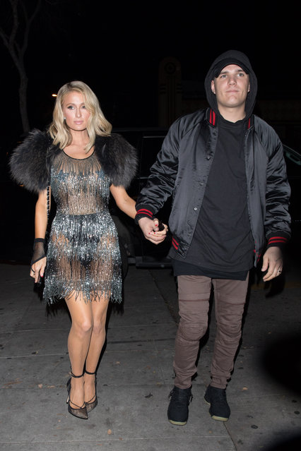 Paris Hilton is seen in a see through dress with finance Chris Zylka as they head to the iheart radio award after party at Delilah in West Hollywood on March 13, 2018. (Photo by Mr.Canon/Splash News and Pictures)