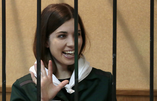 Nadezhda Tolokonnikova, a member of the feminist punk band, p*ssy Riot, waves to supporters at a district court in Zubova Polyana 440 km southeast of Moscow in Russia's province of Mordovia, Friday, April 26, 2013. A Russian court is to consider whether one of the jailed p*ssy Riot members is eligible for early release. Nadezhda Tolokonnikova, in custody since her arrest in March 2012, is serving a two-year sentence for the band's irreverent protest against President Vladimir Putin in Moscow's main cathedral. (Photo by Mikhail Metzel/AP Photo)