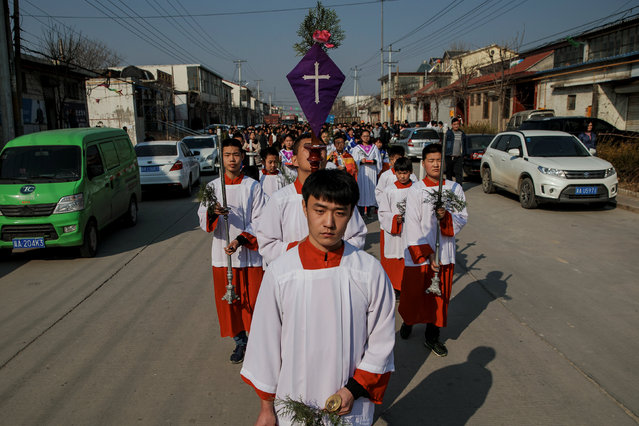 The Palm Sunday procession makes its way towards a government-sanctioned church in Youtong village, Hebei province, China, March 25, 2018. (Photo by Damir Sagolj/Reuters)