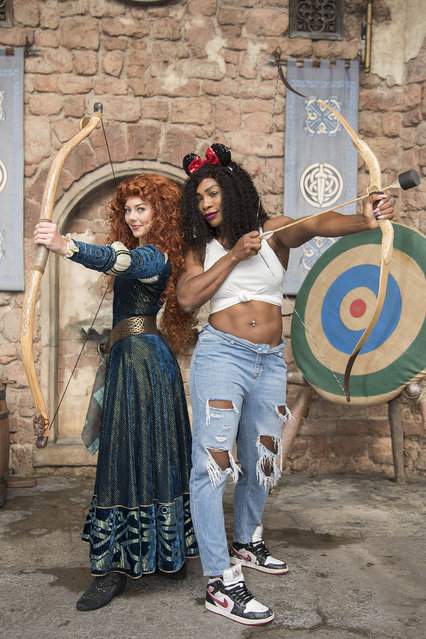 """Tennis superstar Serena Williams strikes a """"brave"""" pose with Princess Merida from the Disney Pixar film """"Brave"""" on October 16, 2016, at Magic Kingdom Park in Lake Buena Vista, Fla. The athlete, who is tied for the record for most career Grand Slam titles, spent some time vacationing at Walt Disney World before resuming training for the season-ending WTA Finals in Singapore. (Photo by Preston Mack/Disney/Splash News)"""