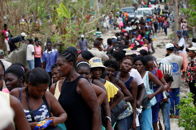 People make a line as they wait for food to be handed out after Hurricane Matthew hit Jeremie, Haiti, October 19, 2016. (Photo by Carlos Garcia Rawlins/Reuters)