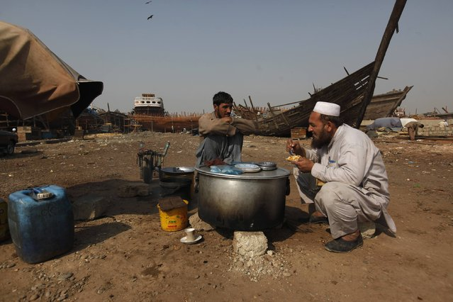 A man eats his lunch of boiled rice at a makeshift stall in Karachi's Fish Harbour December 31, 2014. (Photo by Akhtar Soomro/Reuters)