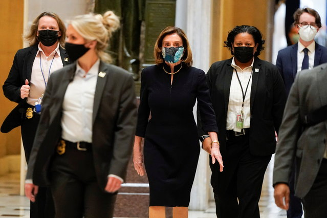 U.S. House Speaker Nancy Pelosi (D-CA) walks to the House Chamber, as Democrats debate one article of impeachment against U.S. President Donald Trump at the U.S. Capitol, in Washington, U.S. January 13, 2021. (Photo by Joshua Roberts/Reuters)
