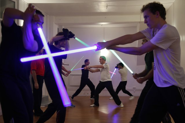 Members of the Sport Saber League practise light saber during a training session in Paris, France, November 10, 2015. (Photo by Charles Platiau/Reuters)