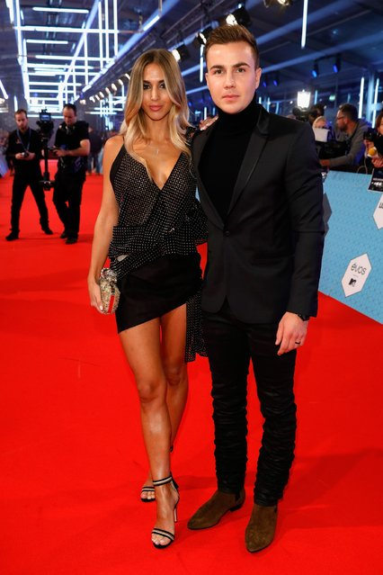 Mario Goetze (R) and Ann-Kathrin Broemmel attend the MTV Europe Music Awards 2016 on November 6, 2016 in Rotterdam, Netherlands. (Photo by Andreas Rentz/Getty Images for MTV)