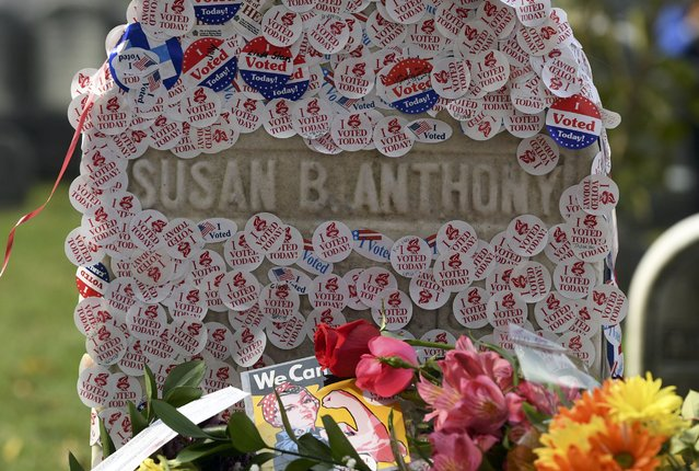 "The grave of women's suffrage leader Susan B. Anthony is covered with ""I Voted"" stickers left by voters in the U.S. presidential election, at Mount Hope Cemetery in Rochester, New York November 8, 2016. (Photo by Adam Fenster/Reuters)"