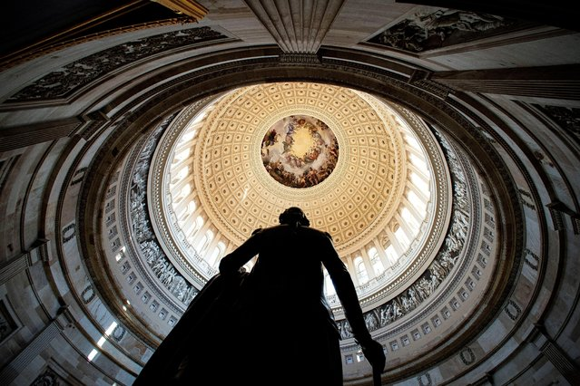 Rotunda of the U.S. Capitol is seen behind a statue of former President George Washington, before the second impeachment trial for former President Donald Trump, at the Capitol in Washington, February 9, 2021. (Photo by Al Drago/Reuters)