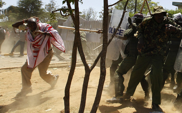 Riot policemen disperse residents during protests to oust the Narok county Governor Samuel Tunai in Narok, Kenya, January 26, 2015. (Photo by Thomas Mukoya/Reuters)