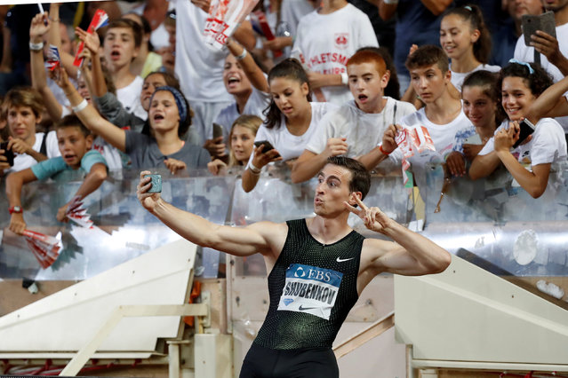 Russia' s Sergey Shubenkov celebrates after winning the men' s 110 m hurdles race during the IAAF Diamond League Athletics meeting at the Louis II Stadium in Monaco, Friday, July 20, 2018. (Photo by Eric Gaillard/Reuters)