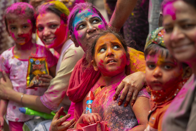 Indians smeared in color participate in Holi festival celebrations in Gauhati, India, Monday, March 29, 2021. (Photo by Anupam Nath/AP Photo)